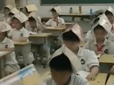 中国の小学校で頭に教科書乗せるスタイル